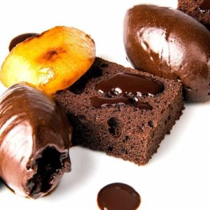 Chocolate genoise with dark chocolate ganache, caramelised pear and cocoa syrup – Great British Chefs